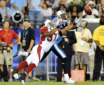 NASHVILLE, TN - AUGUST 23:  Trumaine McBride #37 of the Arizona Cardinals breaks up a pass intended for Nate Washington #85 of the Tennessee Titans during the first half of a preseason game at LP Field on August 23, 2010 in Nashville, Tennessee.  (Photo b