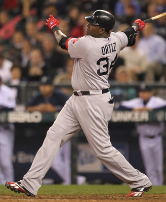 SEATTLE - SEPTEMBER 14:  David Ortiz #34 of the Boston Red Sox hits a three run homer in the eighth inning against the Seattle Mariners at Safeco Field on September 14, 2010 in Seattle, Washington. The Red Sox won 9-6. (Photo by Otto Greule Jr/Getty Image