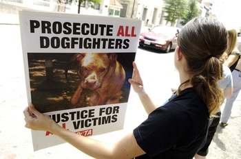 RICHMOND, VA - JULY 26:  Protestors from People for the Ethical Treatment of Animals carry signs as they wait for Atlanta Falcons quarterback Michael Vick to appear for a bond hearing and arraignment in federal court July 26, 2007 in Richmond, Virginia. V