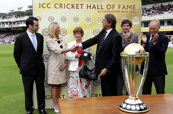 LONDON, ENGLAND - AUGUST 28:  ICC director Giles Clarke (3rdR), MCC President John Barclay (2ndR) and Yorkshire CCC Chairman Colin Graves (R) present a commemorative cap to Herbert Sutcliffe's daughter-in-law Laurel (3rdL) and grandchildren Victoria (2ndL