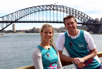 SYDNEY, AUSTRALIA - SEPTEMBER 16:  Australian winter Olympic gold medallist Torah Bright and Glenn McGrath pose during a Sydney Running Festival Press Conference at Sydney Opera House on September 16, 2010 in Sydney, Australia.  (Photo by Mark Metcalfe/Ge