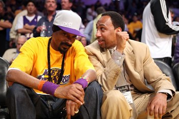 LOS ANGELES, CA - JUNE 15:  Rapper Snoop Dogg talks with radio host Stephen A. Smith as they sits courtside in Game Six of the 2010 NBA Finals between the Boston Celtics and the Los Angeles Lakers at Staples Center on June 15, 2010 in Los Angeles, Califor