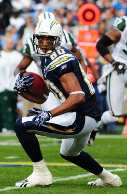 SAN DIEGO - JANUARY 17:  Wide receiver Malcom Floyd #80 of the San Diego Chargers looks to run with the ball after a catch against the New York Jets during  AFC Divisional Playoff Game at Qualcomm Stadium on January 17, 2010 in San Diego, California.  (Ph