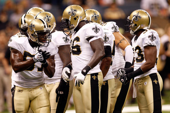 NEW ORLEANS - AUGUST 21:  Jonathan Vilma #51 of the New Orleans Saints talks with the defence against the Houston Texans at the Louisiana Superdome on August 21, 2010 in New Orleans, Louisiana.  (Photo by Chris Graythen/Getty Images)