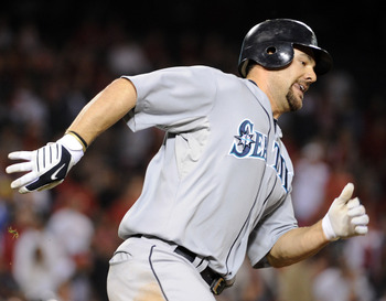 ANAHEIM, CA - SEPTEMBER 10:  Casey Kotchman #13 of the Seattle Mariners doubles in the tying run of Jose Lopez #4 against the Los Angeles Angels of Anaheim during the ninth inning at Angel Stadium on September 10, 2010 in Anaheim, California.  (Photo by H