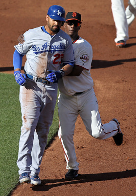 SAN FRANCISCO - AUGUST 1:  Edgar Renteria #16 of the San Francisco Giants tags out Matt Kemp #27 of the Los Angeles Dodgers on a run down during an MLB game at AT&T Park on August 1, 2010 in San Francisco, California. (Photo by Jed Jacobsohn/Getty Images)