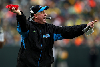 GREEN BAY, WI - NOVEMBER 30:  Head coach John Fox of the Carolina Panthers throws a red challenge flag against the Green Bay Packers at Lambeau Field on November 30, 2008 in Green Bay, Wisconsin.  (Photo by Jonathan Daniel/Getty Images)