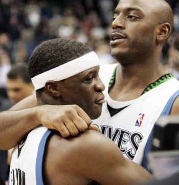 MINNEAPOLIS, MN - OCTOBER 28: Jonny Flynn #10 of the Minnesota Timberwolves celebrates with teammate Damien Wilkins #3 after Wilkins hit the game-winning shot at the buzzer to defeat the New Jersey Nets 95-93 at the Target Center on October 28, 2009 in Mi