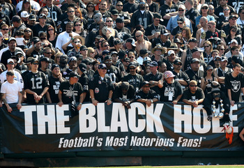 OAKLAND, CA - SEPTEMBER 27: Fans of the Oakland Raiders look on against the Denver Broncos on September 27, 2009 during an NFL game at the Oakland-Alameda County Coliseum in Oakland, California.  (Photo by Jed Jacobsohn/Getty Images)
