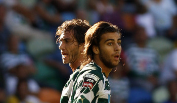 LISBON, PORTUGAL - AUGUST 22:  Defender Nuno Coelho (L) and midfielder Andre Santos (R) of Sporting Lisbon  react during the Portuguese Liga football match between Sporting Lisbon and  Maritimo at Alvalade Stadium on August 22, 2010 in Lisbon, Portugal. (