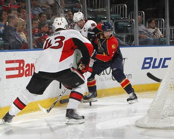 SUNRISE, FL - APRIL 6: Clay Wilson #3 of the Florida Panthers battles behind th enet for the puck with Daniel Alfredsson #11 and Peter Regin #43 of the Ottawa Senators on April 6, 2010 at the BankAtlantic Center in Sunrise, Florida. The Senators defeated