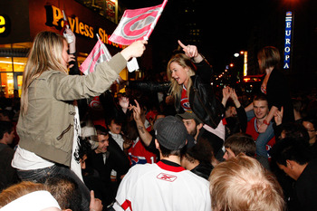 MONTREAL- MAY 12:   Fans celebrate the Montreal Canadiens defeating the Pittsburgh Penguins in Game Seven of the Eastern Conference Semifinals during the 2010 NHL Stanley Cup Playoffs at the Bell Centre on May 12, 2010 in Montreal, Quebec, Canada.  The Ca