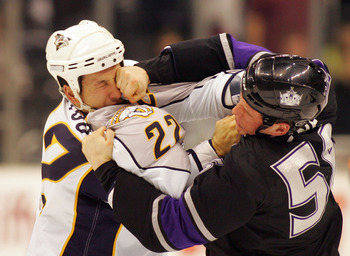 LOS ANGELES, CA - MARCH 14:  Richard Clune #56 of Los Angeles Kings punches Jordin Tootoo #22 of the Nashville Predators during their fight in the second period of their NHL game at the Staples Center on March 14, 2010 in Los Angeles, California.  (Photo