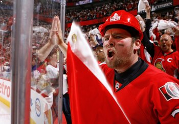 OTTAWA, ON - APRIL 24:  An Ottawa Senators' fan show his support in Game 6 of the Eastern Conference Quaterfinals against the Pittsburgh Penguins during the 2010 Stanley Cup Playoffs at Scotiabank Place on April 24, 2010 in Ottawa, Canada.  (Photo by Phil