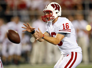LAS VEGAS - SEPTEMBER 04:  Quarterback Scott Tolzien #16 of the Wisconsin Badgers takes a snap during a game against the UNLV Rebels at Sam Boyd Stadium September 4, 2010 in Las Vegas, Nevada.  (Photo by Ethan Miller/Getty Images)