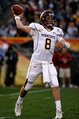 TEMPE, AZ - DECEMBER 31:  Quarterback Adam Weber #8 of the Minnesota Golden Gophers throws a pass during the second quarter of the Insight Bowl against the Iowa State Cyclones at Arizona Stadium on December 31, 2009 in Tempe, Arizona.  (Photo by Christian