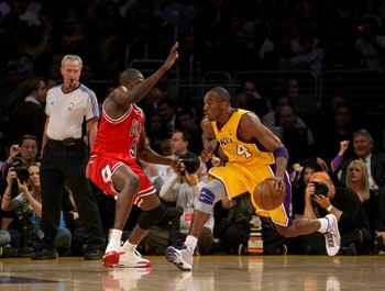 LOS ANGELES, CA - NOVEMBER 18:  Kobe Bryant #24 of the Los Angeles Lakers controls the ball against Luol Deng #9 of the Chicago Bulls on November 18, 2008 at Staples Center in Los Angeles, California.  NOTE TO USER: User expressly acknowledges and agrees