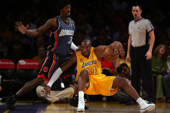 LOS ANGELES, CA - MARCH 26:  Kobe Bryant #24 of the Los Angeles Lakers slips while being guarded by Gerald Wallace #3 of the Charlotte Bobcats during the first quarter at Staples Center on March 26, 2008 in Los Angeles, California. NOTE TO USER: User expr