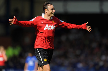 LIVERPOOL, ENGLAND - SEPTEMBER 11:  Dimitar Berbatov of Manchester United celebrates scoring to make it 3-1 during the Barclays Premier League match between Everton and Manchester United at Goodison Park on September 11, 2010 in Liverpool, England.  (Phot