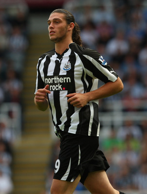 NEWCASTLE UPON TYNE, ENGLAND - SEPTEMBER 11:  Newcastle forward Andy Carroll in action during the Barclays Premier League match between Newcastle United and Blackpool at St James' Park on September 11, 2010 in Newcastle upon Tyne, England.  (Photo by Stu
