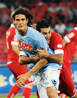 NAPLES, ITALY - SEPTEMBER 12:  Edinson Cavani  of Napoli and Nicola Belmonte of Bari in action  during the Serie A match between Napoli and Bari at Stadio San Paolo on September 12, 2010 in Naples, Italy.  (Photo by Giuseppe Bellini/Getty Images)