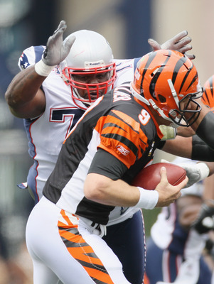 FOXBORO, MA - SEPTEMBER 12:  Vince Wilfork #75 of the New England Patriots sacks Carson Palmer #9 of the Cincinnati Bengals during the NFL season opener on September 12, 2010 at Gillette Stadium in Foxboro, Massachusetts.  (Photo by Elsa/Getty Images)
