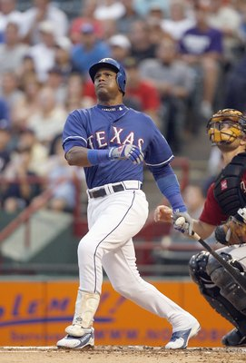 ARLINGTON, TX - JUNE 24: Sammy Sosa #21of the Texas Rangers follows his hit against the Houston Astros on June 24, 2007 at the Rangers Ballpark in Arlington, Texas. The Astros won 12-9. (Photo by Layne Murdoch/Getty Images).