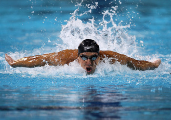 IRVINE, CA - AUGUST 21:  Michael Phelps swims the butterfly leg of the 4X100m medley relay during the Mutual of Omaha Pan Pacific Championships at the William Woollett Jr. Aquatic Center on August 21, 2010 in Irvine, California.  (Photo by Stephen Dunn/Ge