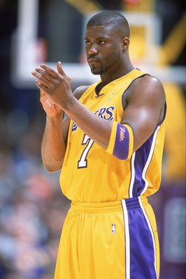 7 Feb 2001:  Isaiah Rider #7 of the Los Angeles Lakers claps his hands during the game against the Phoenix Sun at the STAPLES Center in Los Angeles, California.  The Lakers defeated the Suns 85-83.   NOTE TO USER: It is expressly understood that the only