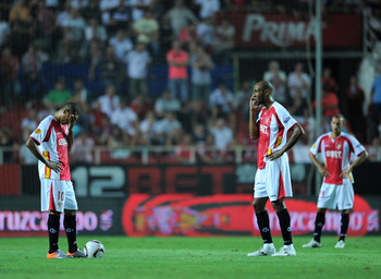 SEVILLE, SPAIN - SEPTEMBER 16:  Luis Fabiano (L) of Sevilla stands dejected with his teammate Frederic Kanoute waiting to resume the game after conceding a goal during the UEFA Europa League group J match between Sevilla and Paris Saint Germain at the Est
