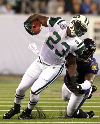 EAST RUTHERFORD, NJ - SEPTEMBER 13:  Shonn Greene #23 of the New York Jets gets tackeled by Jameel McClain #53 of the Baltimore Ravens during their home opener at the New Meadowlands Stadium on September 13, 2010 in East Rutherford, New Jersey.  (Photo by