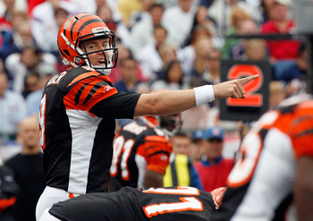 FOXBORO, MA - SEPTEMBER 12: Quarterback Carson Palmer #9 of the Cincinnati Bengals gesttures during the NFL season opener against the New England Patriots  at Gillette Stadium on September 12, 2010 in Foxboro, Massachusetts. (Photo by Jim Rogash/Getty Ima