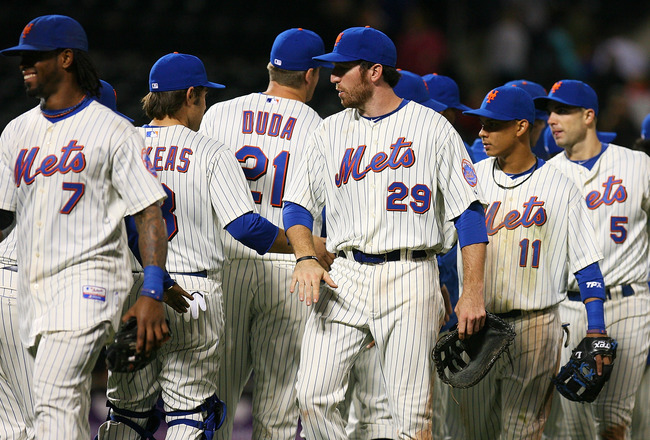 NEW YORK - SEPTEMBER 15:  The New York Mets give each other high-fives after beating the Pittsburgh Pirates 8 - 7 on September 15, 2010 at Citi Field in the Flushing neighborhood of the Queens borough of New York City.  (Photo by Andrew Burton/Getty Image