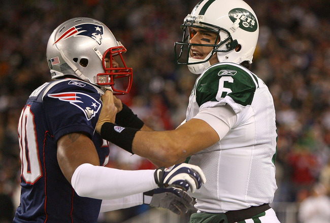 FOXBORO, MA - NOVEMBER 22: Brandon McGowan #30 of the New England Patriots and Mark Sanchez #6 get tangled during a game against the New York Jets at Gillette Stadium on November 22, 2009 in Foxboro, Massachusetts. (Photo by Jim Rogash/Getty Images)