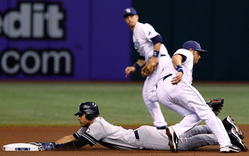 ST. PETERSBURG, FL - SEPTEMBER 15:  Shortstop Derek Jeter #2 of the New York Yankees steals second base as shortstop Jason Bartlett #8 of the Tampa Bay Rays is late with the tag during the game at Tropicana Field on September 15, 2010 in St. Petersburg, F