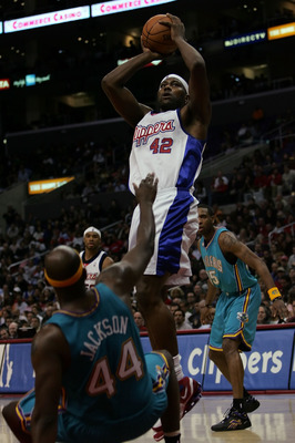 LOS ANGELES, CA - APRIL 18:  Elton Brand #42 of the Los Angeles Clippers goes up for a shot in the lane as he crashes into Marc Jackson #44 of the New Orleans/Oklahoma City Hornets in the second half at Staples Center on April 18, 2007 in Los Angeles, Cal