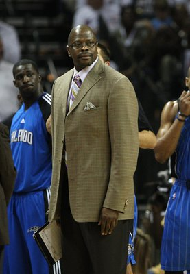 CHARLOTTE - APRIL 24:  Assistant coach Patrick Ewing (C) of the Orlando Magic looks at the referee (not pictured) during a timeout in Game Three of the Eastern Conference Quarterfinals against the Charlotte Bobcats during the 2010 NBA Playoffs at Time War