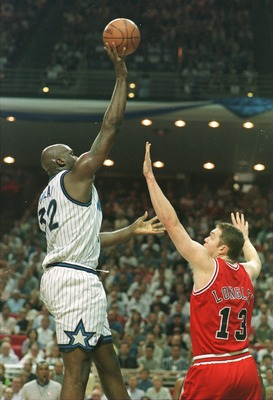 25 May 1996:  Center Shaquille O''Neal (left) of the Orlando Magic shoots over Luc Longley of the Chicago Bulls during game 3 of the Eastern Conference Finals at the Orlando Arena in Orlando, Florida.     Mandatory Credit: Jonathan Daniel/Allsport