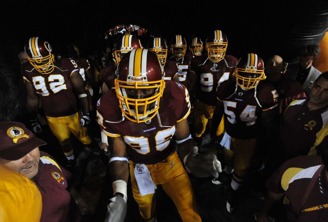 LANDOVER - SEPTEMBER 12:  The Washington Redskins prepare to run out onto the field before the NFL season opener against the Dallas Cowboys at FedExField on September 12, 2010 in Landover, Maryland. The Redskins defeated the Cowboys 13-7. (Photo by Larry
