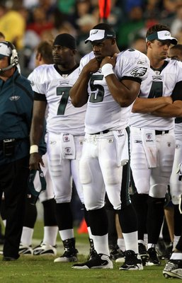 PHILADELPHIA - AUGUST 27:  Donovan McNabb #5, Michael Vick #7, and Kevin Kolb #4 of the Philadelphia Eagles look on from the sidelines against the Jacksonville Jaguars on August 27, 2009 at Lincoln Financial Field in Philadelphia, Pennsylvania.  (Photo by