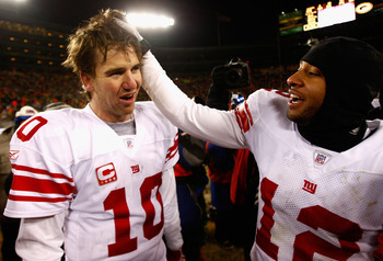 GREEN BAY, WI - JANUARY 20:  Quarterback Eli Manning #10 of the New York Giants celebrates with Steve Smith #12 after winning the NFC championship game against the Green Bay Packers on January 20, 2008 at Lambeau Field in Green Bay, Wisconsin.   The Giant