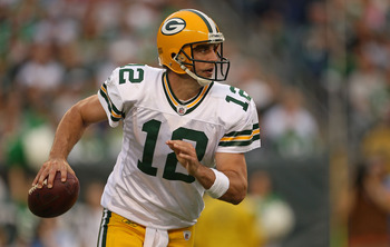 PHILADELPHIA - SEPTEMBER 12:  Aaron Rodgers #12 of the Green Bay Packers looks to pass during a game against the Philadelphia Eagles at Lincoln Financial Field on September 12, 2010 in Philadelphia, Pennsylvania.  (Photo by Mike Ehrmann/Getty Images)