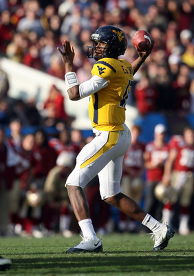 JACKSONVILLE, FL - JANUARY 01: Quarterback Geno Smith #12 of the West Virginia Mountaineers throws a pass against the Florida State Seminoles during the Konica Minolta Gator Bowl on January 1, 2010 at Jacksonville Municipal Stadium in Jacksonville, Florid