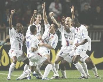 Lyon players celebrating