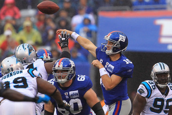 EAST RUTHERFORD, NJ - SEPTEMBER 12:  Eli Manning #10 of the New York Giants throws a pass against the Carolina Panthers during the NFL season opener at New Meadowlands Stadium on September 12, 2010 in East Rutherford, New Jersey.  (Photo by Chris McGrath/