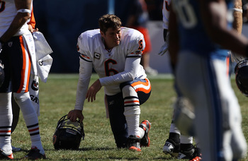 CHICAGO - SEPTEMBER 12: Jay Cutler #6 of the Chicago Bears rests during a time-out against the Detroit Lions during the NFL season opening game at Soldier Field on September 12, 2010 in Chicago, Illinois. The Bears defeated the Lions 19-14. (Photo by Jona
