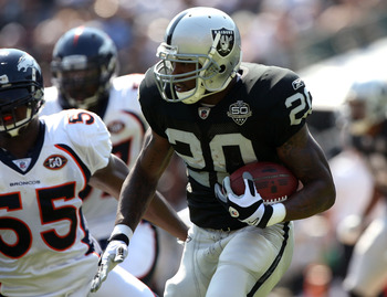 OAKLAND, CA - SEPTEMBER 27: Darren McFadden #20 of the Oakland Raiders runs against the Denver Broncos on September 27, 2009 during an NFL game at the Oakland-Alameda County Coliseum in Oakland, California.  (Photo by Jed Jacobsohn/Getty Images)