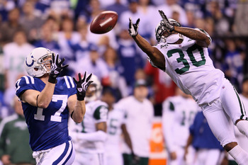 INDIANAPOLIS - JANUARY 24:  Wide receiver Austin Collie #17 of the Indianapolis Colts catches a 46-yard pass in the second quarter over Drew Coleman #30 of the New York Jets during the AFC Championship Game at Lucas Oil Stadium on January 24, 2010 in Indi