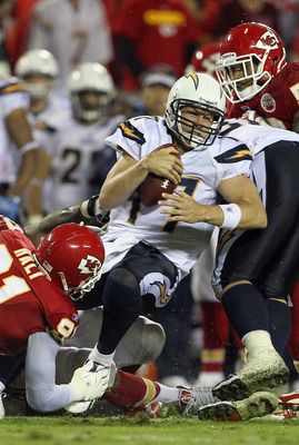 KANSAS CITY, MO - SEPTEMBER 13:  Quarterback Philip Rivers #17 of the San Diego Chargers is sacked during the game against the Kansas City Chiefs on September 13, 2010 at Arrowhead Stadium in Kansas City, Missouri.  (Photo by Jamie Squire/Getty Images)