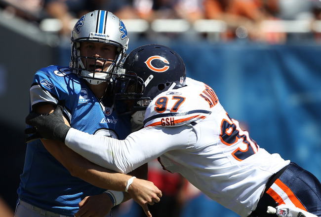CHICAGO - SEPTEMBER 12: Matthew Stafford #9 of the Detroit Lions is hit after throwing a pass by Mark Anderson #97 of the Chicago Bears during the NFL season opening game at Soldier Field on September 12, 2010 in Chicago, Illinois. (Photo by Jonathan Dani